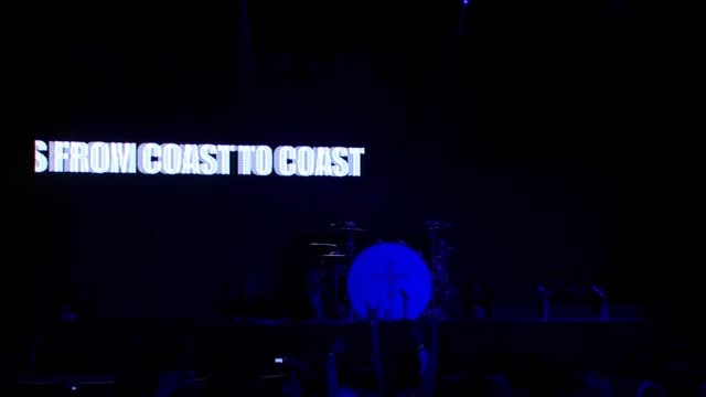 norman perry of live nation and jim richard of kgb radio introduce video montage of crue fest promo at the motley crue press conference at the avalon... - モンタージュ・ビバリーヒルズ点の映像素材/bロール
