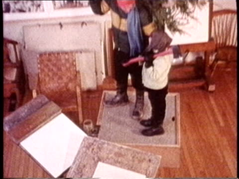 stockvideo's en b-roll-footage met norman rockwell lighting pipe/ oh zi rockwell drawing at desk/ ms rockwell drawing/ tu child watching rockwell and smiling/ zi cu rockwell opening... - 70 79 jaar