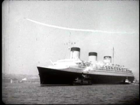 SS Normandie in front of New York Skyline sails into harbor and docks