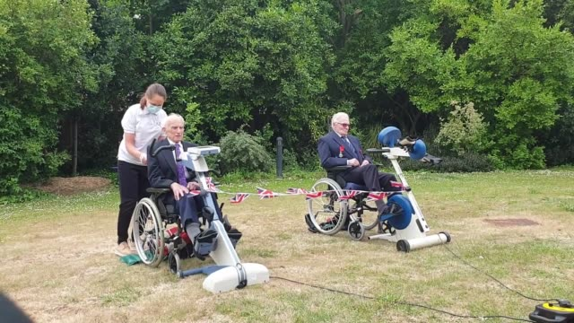 normandy veterans peter hawkins and len gibbon finish their 104-mile cycling challenge, to commemorate anniversary of the normandy landings, in... - worthing点の映像素材/bロール