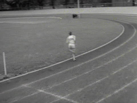 norris mcwhirter times roger bannister as he trains for the four minute mile - timer stock videos and b-roll footage