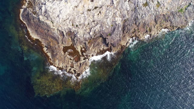 North Aerial view over the waves crashing against the rocks