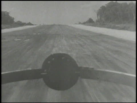 north american b25 mitchell bomber aircraft taxiing on airbase taking off from airstrip landing gear retracting propellers spinning pilot cockpit... - north pacific stock videos & royalty-free footage