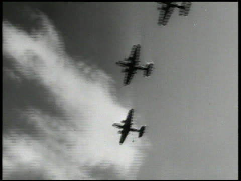 s north american b25 mitchell bomber aircrafts flying dropping bombs shells over cape gloucester explosions on land smoke world war ii wwii pacific... - luftangriff stock-videos und b-roll-filmmaterial