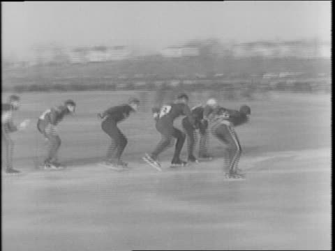stockvideo's en b-roll-footage met north american skating championships at st paul minnesota winter carnival / view of senior men's 220 yard dash / ice skater falls / bob fitzgerald... - 1942