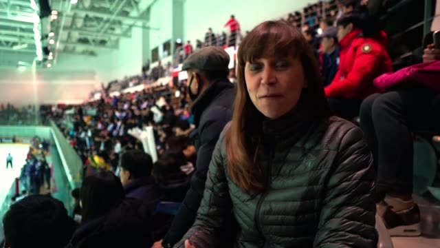 north and south korean women's teams unite to play sweden south korea incheon seonhak international ice rink int reporter to camera - korea stock-videos und b-roll-filmmaterial