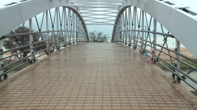 wgn north avenue pedestrian bridge connected to a beach in chicago on april 10 2016 - michigan avenue bridge stock videos and b-roll footage