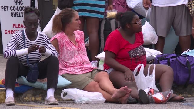 north carolina residents line up in front of an emergency shelter in the port city of wilmington as they brace for hurricane florence - emergency shelter stock videos & royalty-free footage