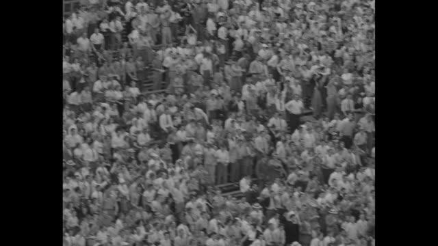 north carolina tar heels team walks onto field in kenan memorial stadium, nc state wolfpack team runs onto field past north carolina team / north... - インターセプト点の映像素材/bロール