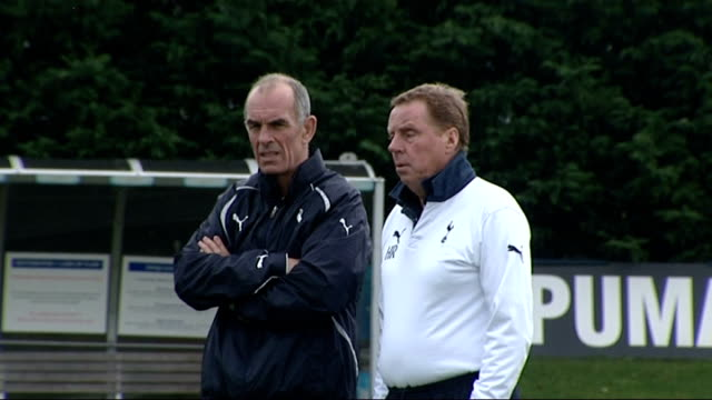 north east london chigwell ext harry redknapp along at spurs training session redknapp and coach watching training - tottenham hotspur f.c stock videos & royalty-free footage