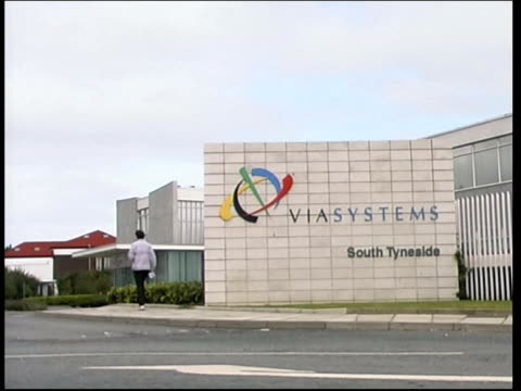 north east south shields entrance to viasystems electronics plant doors to plant workers leaning on rail entrance to plant as cars arrive - south shields stock videos & royalty-free footage