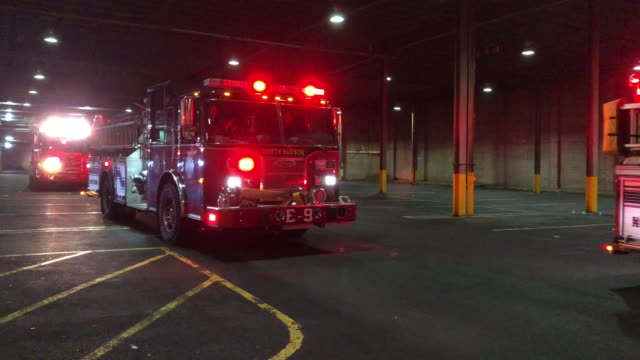north hudson fire engine with siren on arrived at a false alarm scene in new jersey. - fire alarm stock videos & royalty-free footage