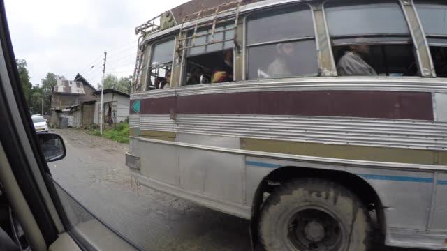 north india street life view from car moving,srinaga,kashmir - jammu e kashmir video stock e b–roll