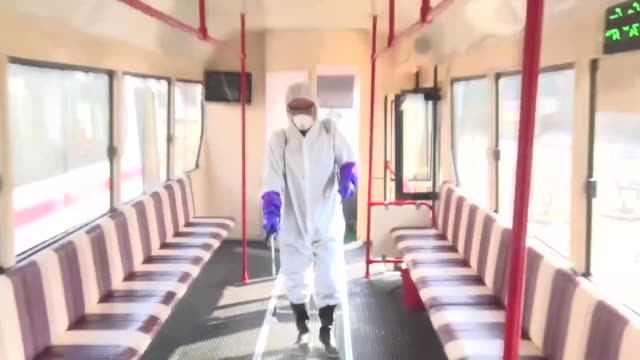 north korea : a worker in a protective suit disinfects a tram car in pyongyang on feb. 26 to prevent new coronavirus infections. - tram stock videos & royalty-free footage