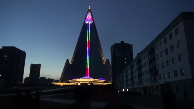 the 300metertall longdormant hotel building that dominates pyongyang's skyline has been lit up in the runup to the anniversary of north korea's... - founder stock videos and b-roll footage