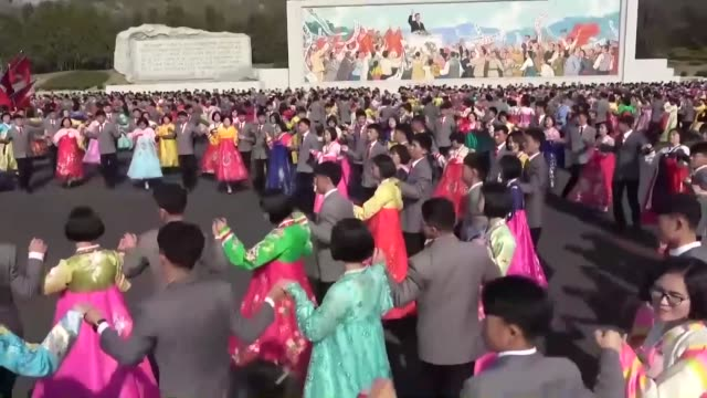 young people dance in pyongyang on april 15 to celebrate the 107th anniversary of the birth of north korea's founder kim il sung - north korea stock videos & royalty-free footage