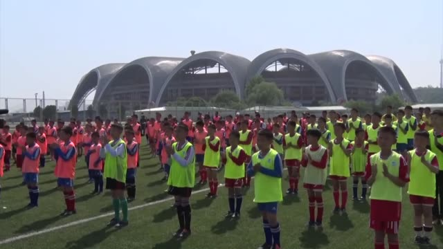 North Korean boys take part in an event in Pyongyang to promote football on May 15 2019