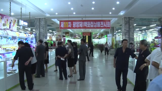 north korea : movie taken july 10 in north korea's capital pyongyang shows an exhibition of everyday items made solely from locally sourced materials. - kaufhaus stock-videos und b-roll-filmmaterial