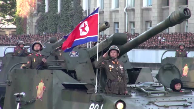 north korea on saturday staged a huge military parade marking the 70th anniversary of the founding of the ruling workers' party, as the international... - weaponry stock videos & royalty-free footage