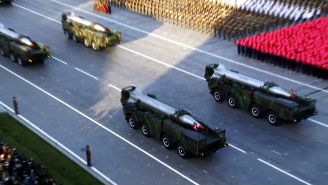 north korea on saturday staged a huge military parade marking the 70th anniversary of the founding of the ruling workers' party as the international... - military parade stock videos & royalty-free footage