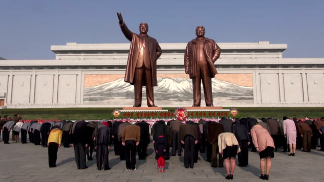 north korea on wednesday marked the 103rd anniversary of the birth of its late founder kim il sung in a jovial mood, at a time when the outside world... - tribute event stock videos & royalty-free footage