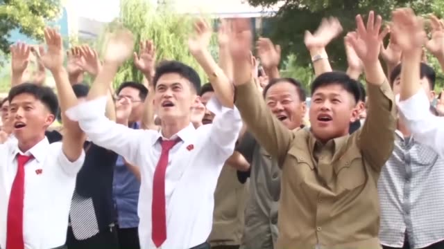 north koreans celebrate in front of a large screen in pyongyang on sept 3after hearing news of the successful test of a hydrogen bomb that can be... - north korea stock videos & royalty-free footage