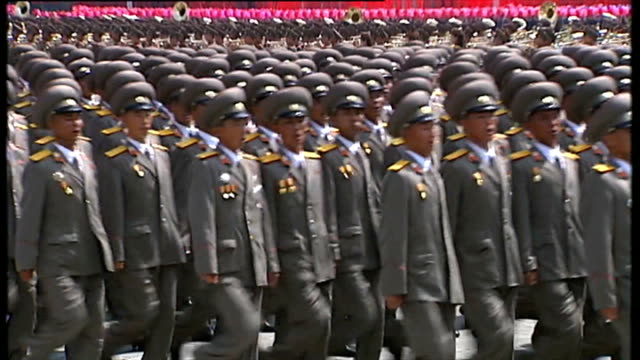 'north korea uncovered' at breaking point t27071311 / tx north korea pyongyang ext various shots north korean soldiers marching in military parade to... - marching stock videos & royalty-free footage