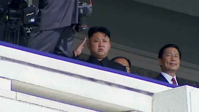 North Korea Uncovered Defectors give evidence to UN human rights council **Music heard SOT** Kim Jong Un saluting Soldiers marching along