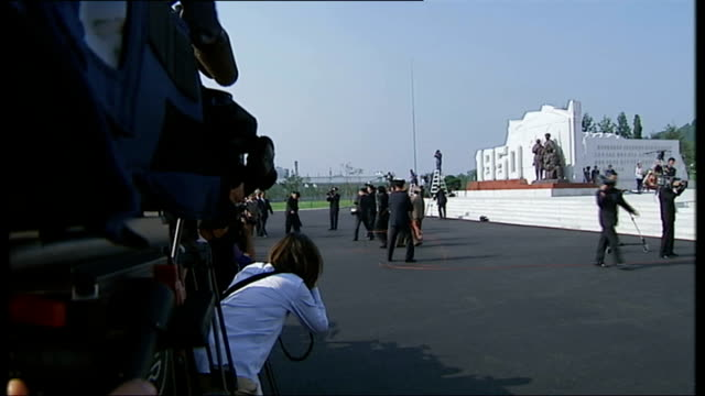 north korea uncovered: defectors give evidence to un human rights council; people along at event marking the end of the korean war sailors lined up... - zoom out 個影片檔及 b 捲影像