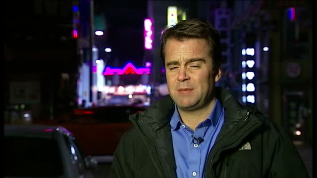 north korea urges all foreigners to leave south korea in new threat of war south korea seoul night reporter to camera - 2013年 北朝鮮の核実験点の映像素材/bロール