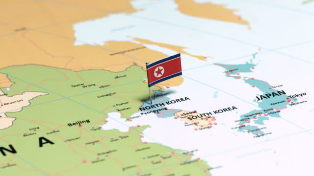 north korea with national flag - north stock videos & royalty-free footage