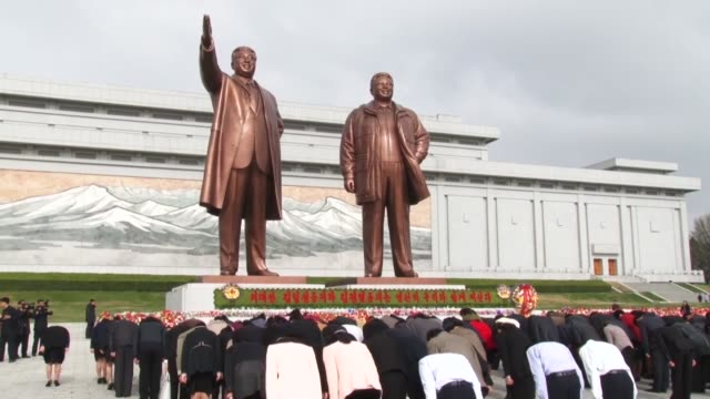north korea on sunday marked the 106th anniversary of the birth of its late founder kim il sung with no signs of provocations towards the... - pyongyang stock videos and b-roll footage