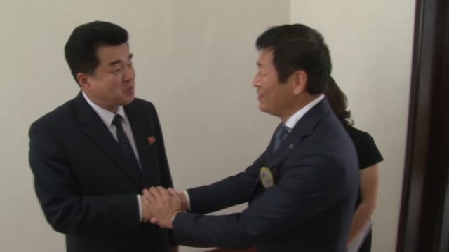 International Gymnastics Federation President Morinari Watanabe of Japan holds talks with North Korean Sports Minister Kim Il Guk who doubles as the...