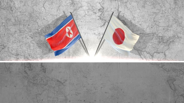 north korean and japanese  flags - north korea stock videos & royalty-free footage
