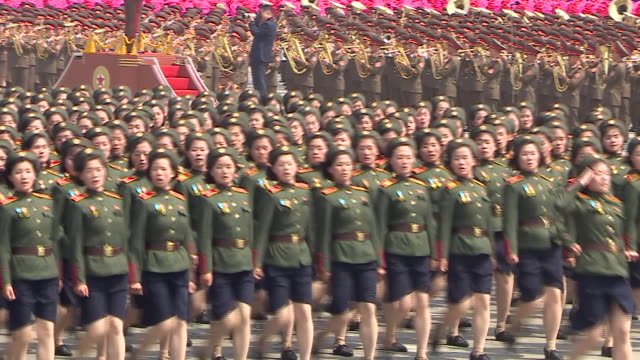 North Korean Army personnel march with their weapons in formation during a parade in countries capital Pyongyang 2017