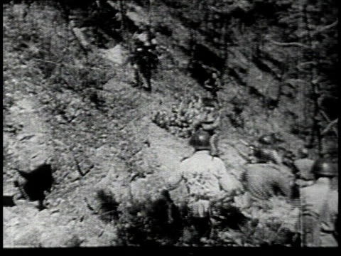 north korean army soldiers climbing and standing atop hill with north korean flag / us army soldiers slogging through water / us army soldiers taking... - korean war stock videos & royalty-free footage