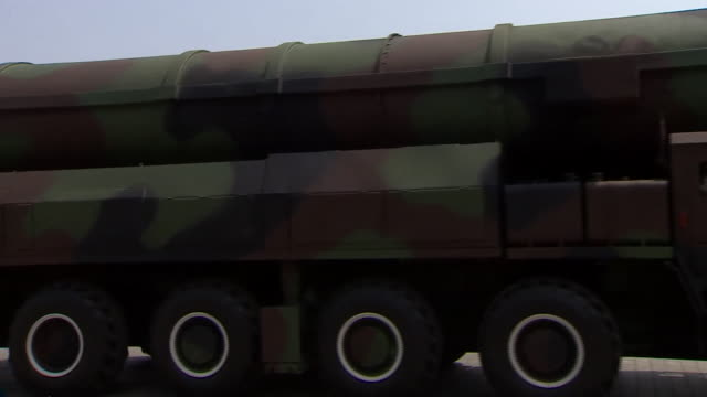 A North Korean army vehicle carries the countires supposedly new nuclear warhead during a parade in the countries capital Pyongyang