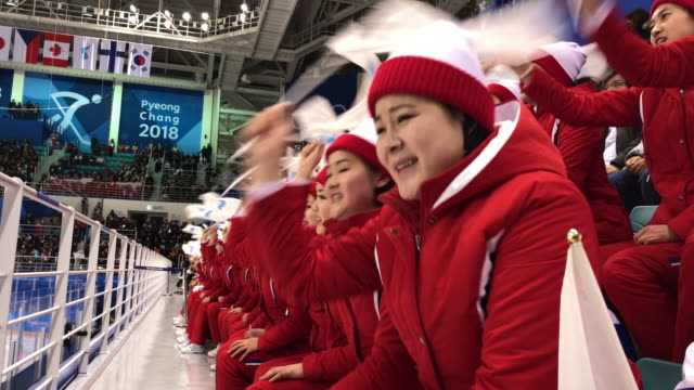North Korean cheerleaders perform during the Women's Ice Hockey Preliminary Round Group B match between North Korea and Switzerland on day one of the...