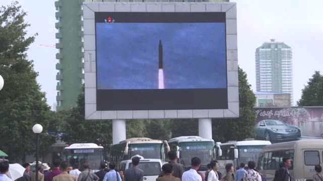 vídeos de stock, filmes e b-roll de north korean citizens react following a test launch of an intermediate range ballistic missile over japanese territory on tuesday - míssil