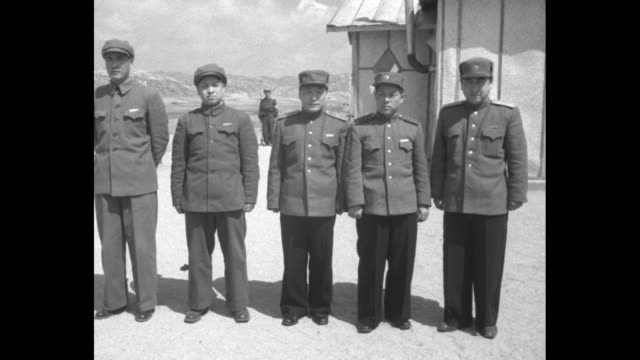 north korean communist negotiating team standing in row for photo opportunity, general lee sang cho in middle, pan across to group of photographers... - team photo stock videos & royalty-free footage