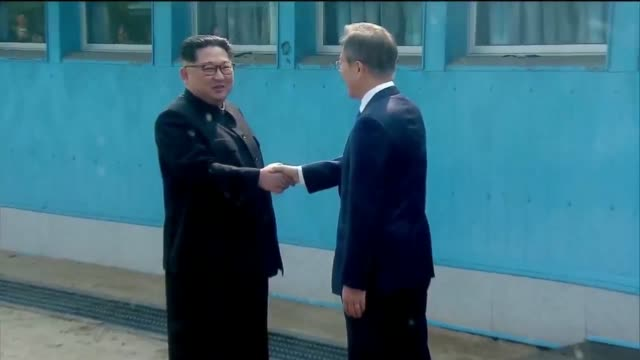 North Korean Leader Kim Jong Un and South Korean President Moon Jaein shake hands over the military demarcation line upon meeting for the InterKorean...