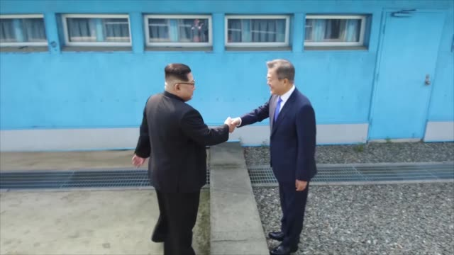 north korean leader kim jong un and south korean president moon jaein shake hands over the military demarcation line upon meeting for the interkorean... - south korea stock videos & royalty-free footage