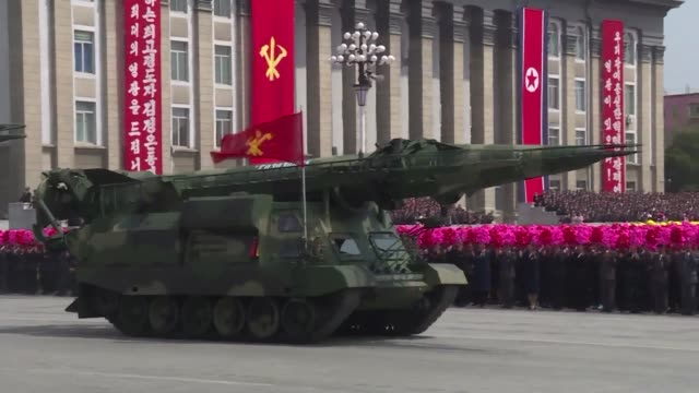 North Korean leader Kim Jong Un salutes as ranks of goose stepping soldiers followed by tanks and other military hardware paraded in Pyongyang for a...