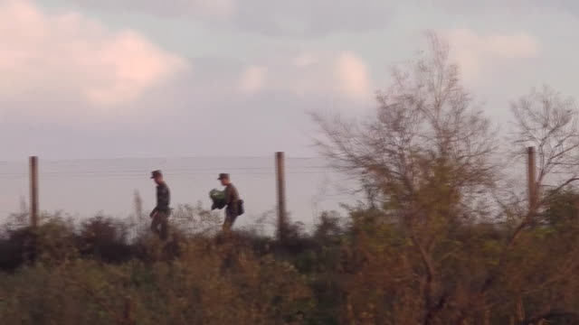 north korean military walk the border fence and wave to chinese tourists on the yalu river near the chinese border - korean ethnicity stock videos & royalty-free footage