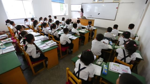 north korean school children in classroom - uniform stock videos & royalty-free footage