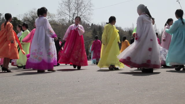 north korean women wear traditional costumes as they dance in celebration of the 100th anniversary of the birth of president kim jong il, april 15th 2012. - tradition stock videos & royalty-free footage