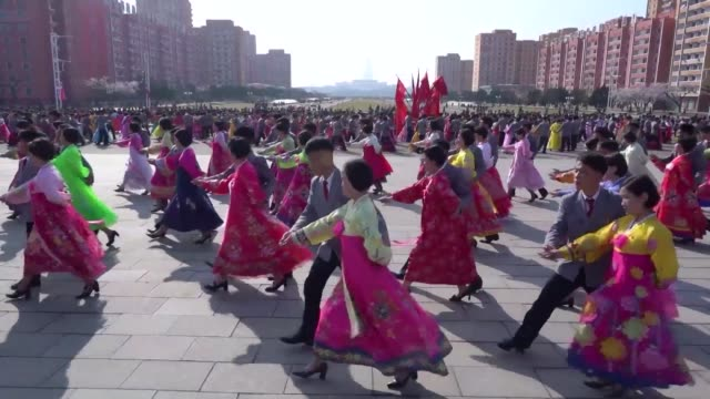 north koreans dress up for a mass dance to celebrate the anniversary of the 1912 birth of the country's founder kim il sung - north korea stock videos & royalty-free footage