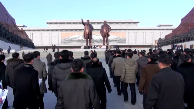 North Koreans gathered at Mansu Hill in Pyongyang to offer flowers in front of giant statues of North Korean state founder Kim Il Sung and his son...
