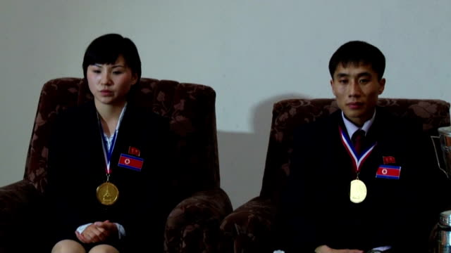 vidéos et rushes de north koreans kim hyok bong and kim jong, who won the mixed doubles competition at the world table tennis championships for individual events held in... - voiture particulière