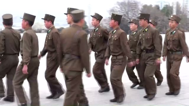 north koreans line up to offer flowers to the statues of former leaders kim il sung and kim jong il from early in the morning in pyongyang to... - korea stock-videos und b-roll-filmmaterial